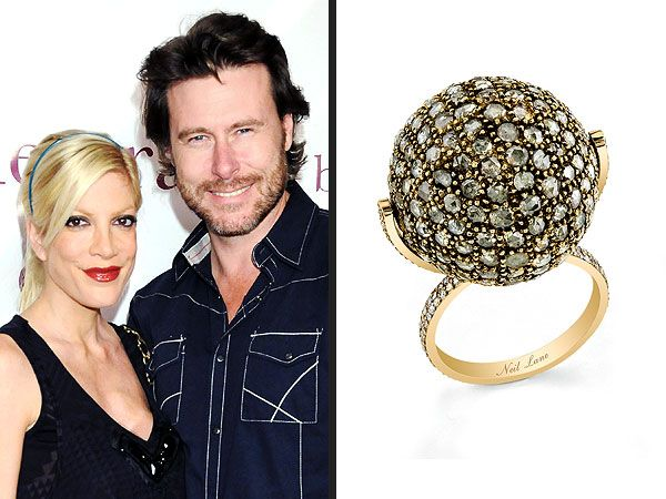 Tori Spelling's 'Spinning' Anniversary Ring from Dean McDermott: custom Neil Lane ring set in 18k gold with over 150 small rose cut diamonds, for a total of about 3 carats.