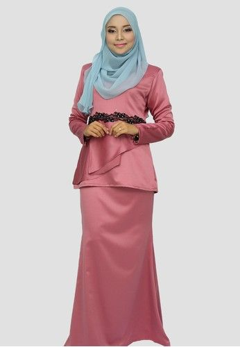 Ayesha Flip Peplum from wandaraffa in Pink Exude elegance and femininity with ayesha flip peplum from wandaraffa. Featuring floral lace and swarovski at waist to shows modest styling at its best. ... #bajukurung #bajukurungmoden
