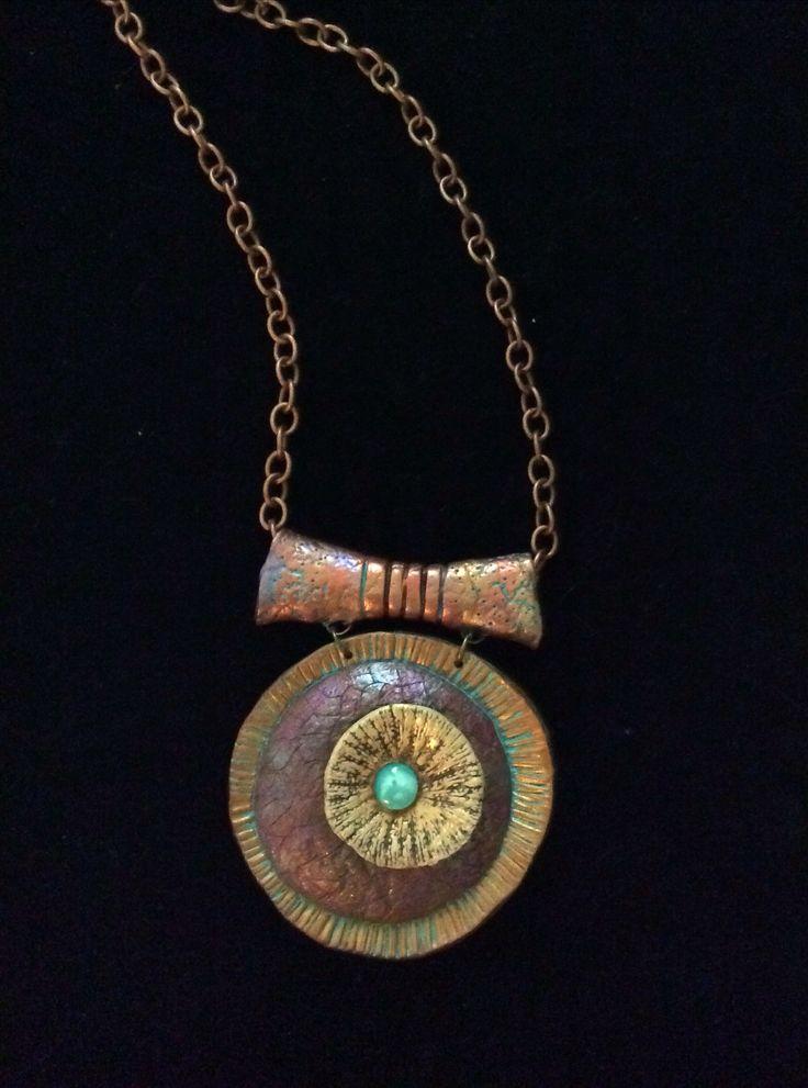 Polymer clay long pendant by Karen Brueggemann.