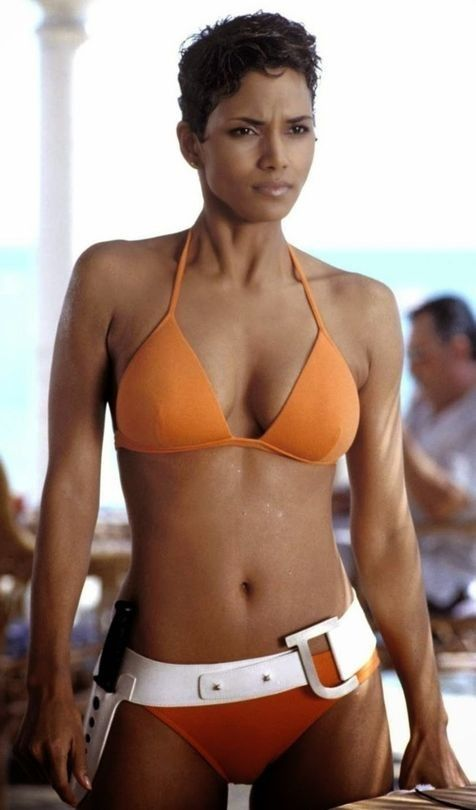 34 iconic moments in swimwear history: 2002: This striking orange belted bikini on Halle Berry in Die Another Day began an decade of neon dreams.