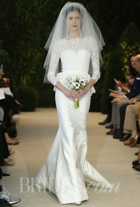 """Brides.com: Our Favorite Lace Wedding Dresses from the Bridal Runways. """"Alyssa"""" ivory silk mikado and lace peplum gown with illusion long-sleeve over sweetheart neckline, Carolina Herrera  See more Carolina Herrera wedding dresses."""