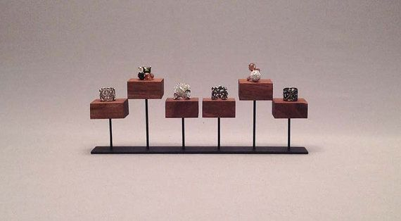 Ring Display  This ring display is perfect to display a multiple rings or even cufflinks. It features spots for six items.  The holders are