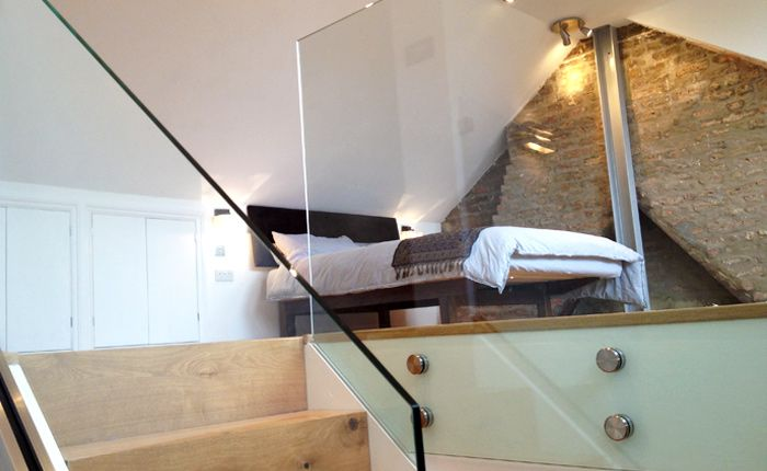 Loft conversion without dormer.  Like the exposed brick and the glass panels.