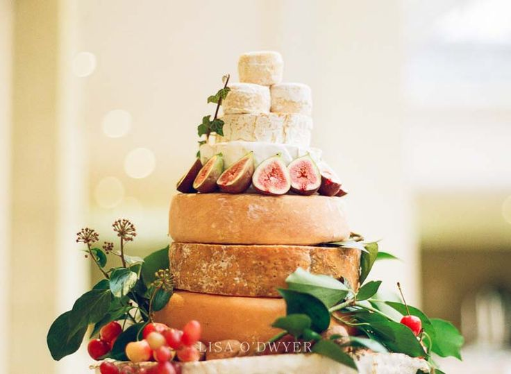 cheese wheel wedding cake | Sheridan's Cheesemongers | Lisa O'Dwyer Photography destination wedding photographer #cheesecakewedding #BonAppetit #weddingcakeofcheese #beautifulweddingcake #alternativeweddingcake #foodiewedding
