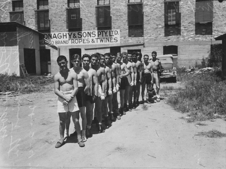Members of the US servicemen's boxing team, Brisbane, February 1943  Members of the US boxing team who competed against Australian servicemen at the inter-allied boxing tournament at the Brisbane Stadium on Saturday 27 February 1943. [Sunday Truth, 21 February 1943]   On the night, the Americans finished behind on points 32-24 and lost 9 fights to 5. It was described as a boisterous and raucous night. [Truth newspaper, 28 February 1943] Neg: 102776 John Oxley Library, State Library of QLD