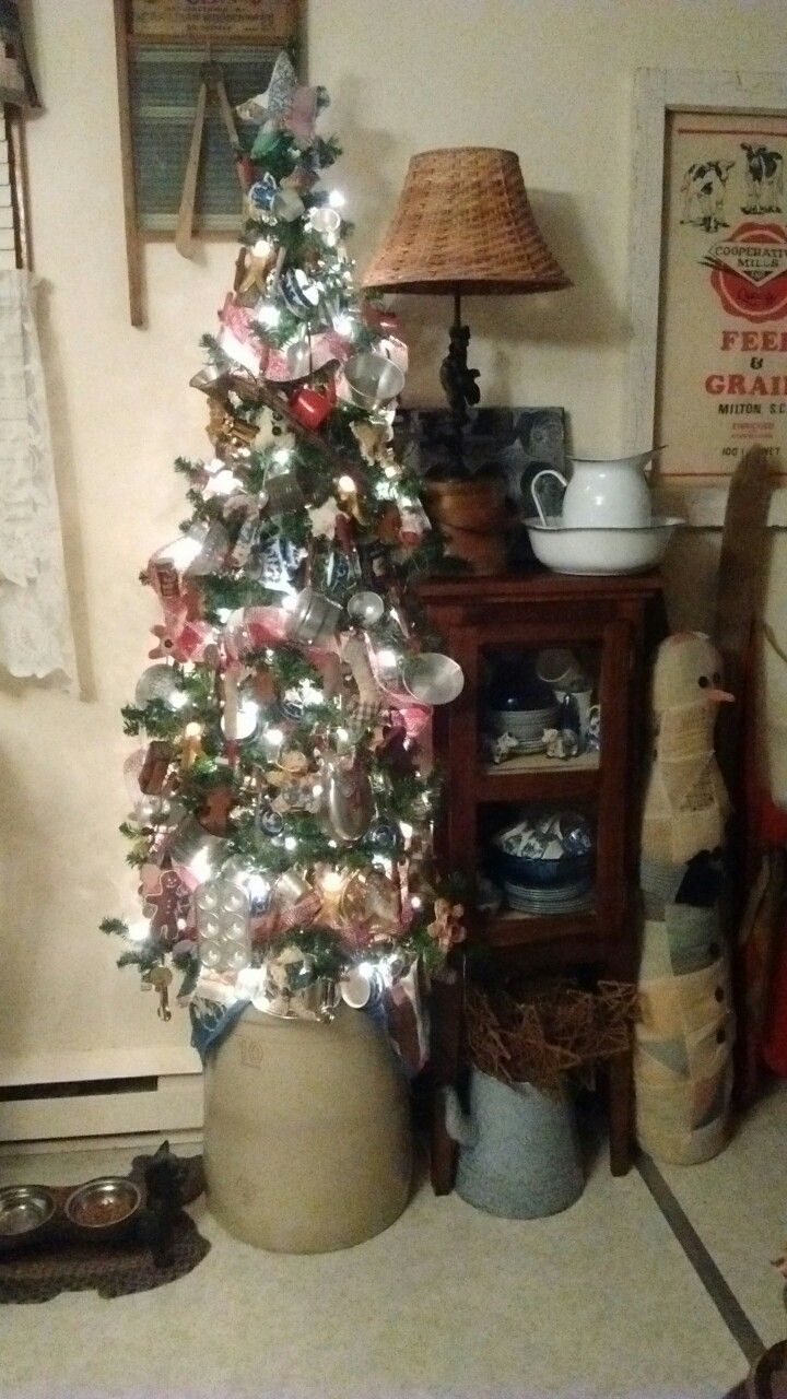 Kitchen tree full of mini blue and white China tea sets, tin pots and pans, cutlery, tools, spice tins and more!