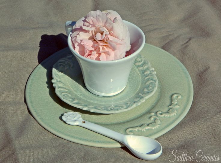 Sailthru Ceramics. Gorgeous teacup in white with crackle glazed saucer in green. And old oak plate with rose spoon.