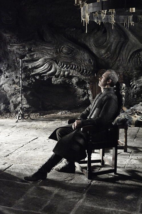 Stannis Baratheon at Dragonstone - Dragonstone is the castle that stands upon the eponymous island located in Blackwater Bay. It is the ancestral seat of House Targaryen and the current stronghold of a cadet branch of House Baratheon. The entire castle is dominated by dragon motifs and reliefs.