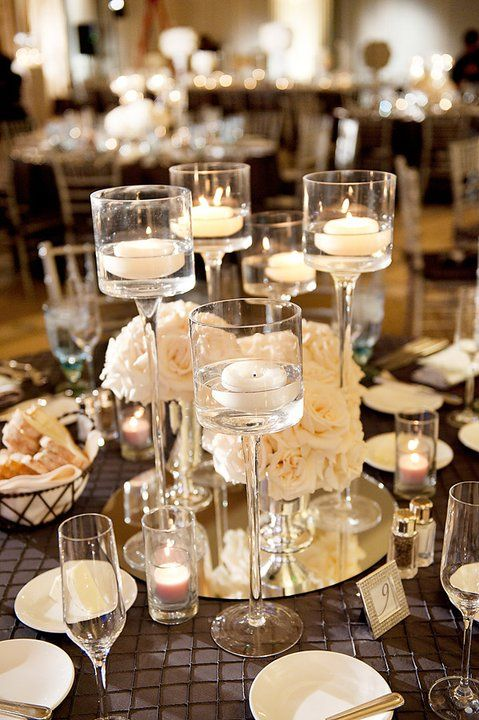 nice look, with the tall candles and flowers.  we could do some very similar with the flowers yo like best.