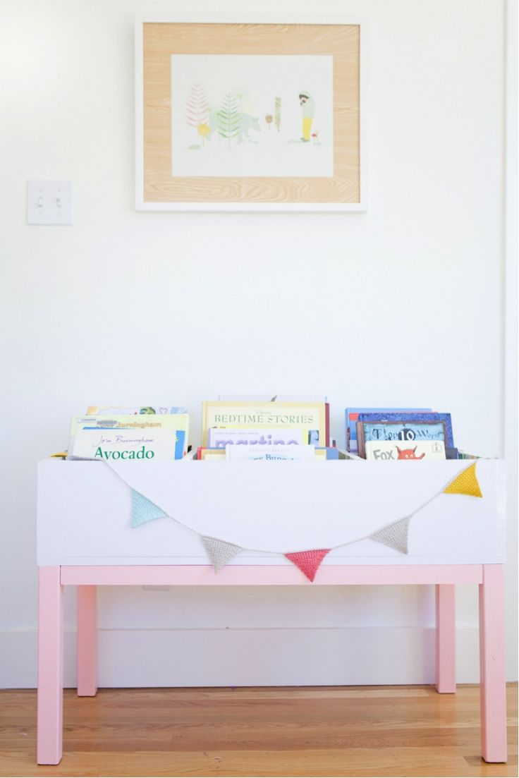 Love this DIY book storage! Would be cute in the living room since Abbi loves to pull all of her books out.