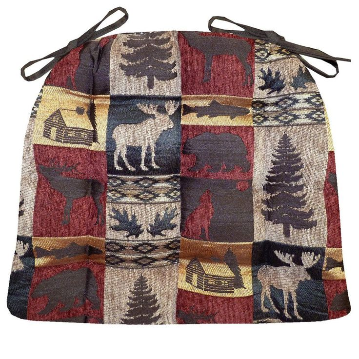 Woodlands Fairbanks dining chair pads feature moose, pines, log cabins and other rustic lodge decor motif in a quilt-block style tapestry of dark red, brown, gold and beige chenille. #lodge #rustic #LodgeDecor