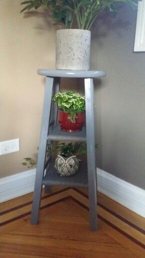 DIY repurposed bar stools - wrapped two levels with twine hot glued at start and finish, then spray painted and added plants.