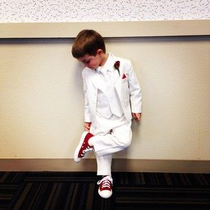 White and red.   Jackie? (assuming he is ring bearer)