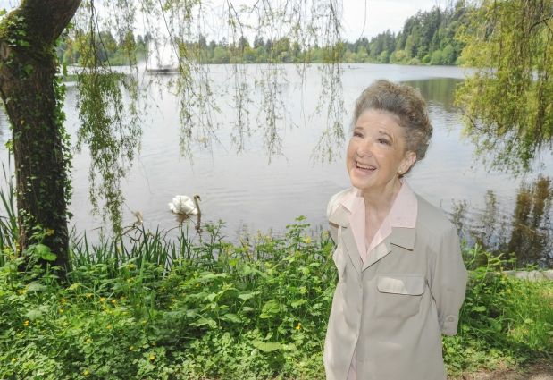 Fiona Sinclair with Tristan, a Mute Swan, at Stanley Park's Lost Lagoon in Vancouver.