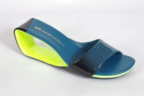 """MOBIUS by United Nude: A slide that will increase the """"wow' factor of any outfit. Mobius features a 2 1/2 inch heel with a patent and leather blue , black and lime upper.  Non slide outsoles."""
