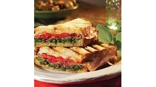 The perfect flavor combo--prosciutto, Provolone, pesto, and roasted bell peppers--on rustic bread and toasted in a panini press makes a great lunch or a quick, light dinner.