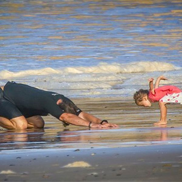 Chris Hemsworth Does Beach Yoga With Daughter India and Gives Her a Big Kiss ~~~Chris Hemsworth and daughter India