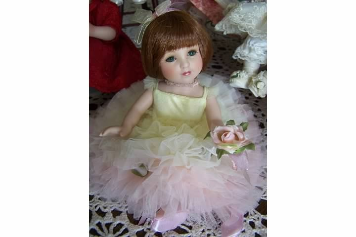 Nancy Peterson's Personal Collection. Peace Rose Bud, sculpted by Sonja Bryer in 2004.  This is a Marie Osmond Doll.
