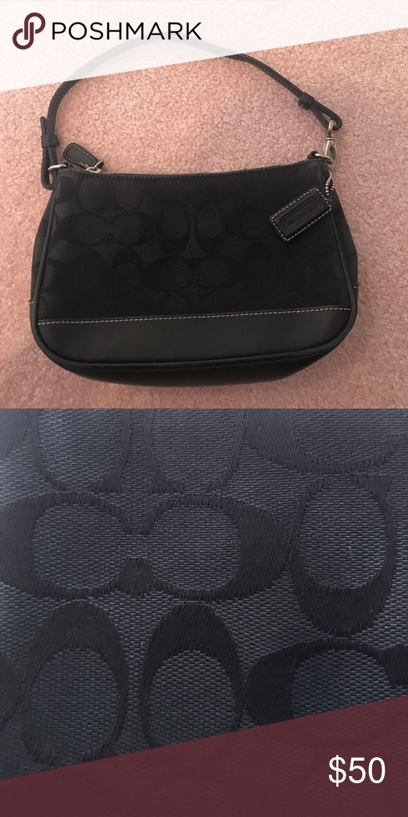 Small black Coach purse Small black Coach bag with leather on the bottom half and Coach embroidery on the top half. Great for a night out. Coach Bags Mini Bags