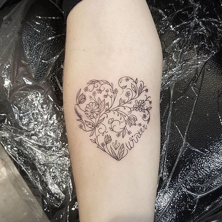 Heart Tattoo by Eloise Entraigues heart floral linework