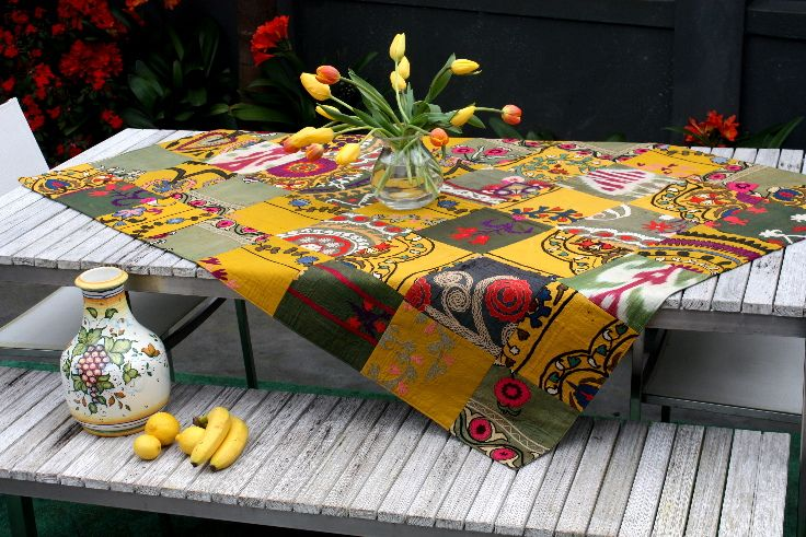 This is a beautiful antique Suzani patchwork throw. Use it as a tablecloth, wall-hanging or bedspread.