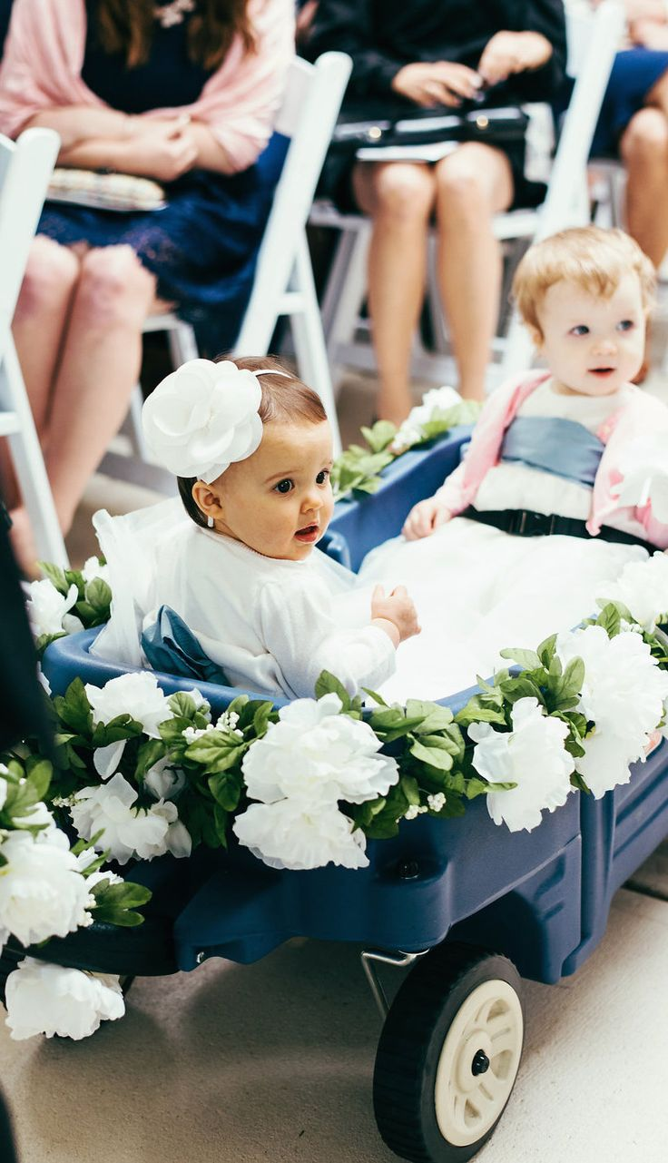 I attached a faux floral garland to the baby flower girl wagon. HOW CUTE ARE THESE TWO?!