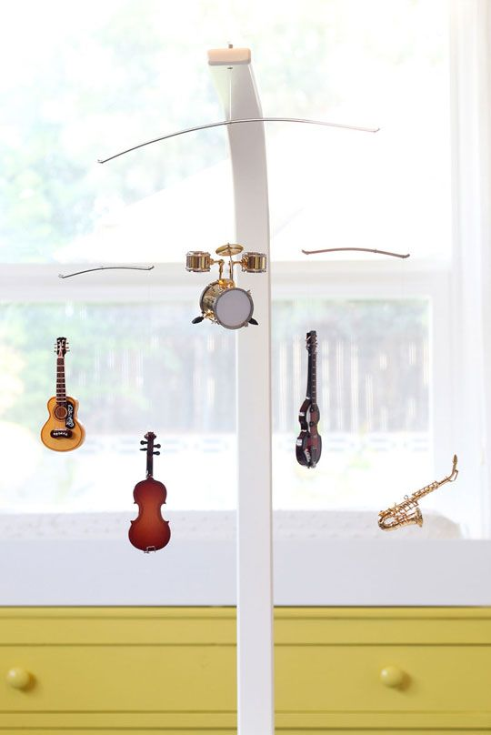 Musical instrument-inspired mobile.  Love it, especially the little drum set!