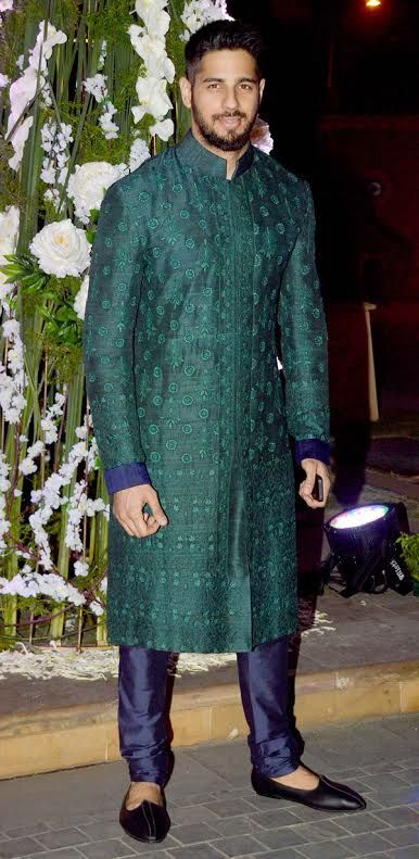 Emerald Green with Indigo Blue: Roll your eyes over this B-town strongman in this combination, and tell us, aren't you swooning over this incredible match of green and blue? Once complete with a good stole, there would be nothing out-of-style about this sherwani.
