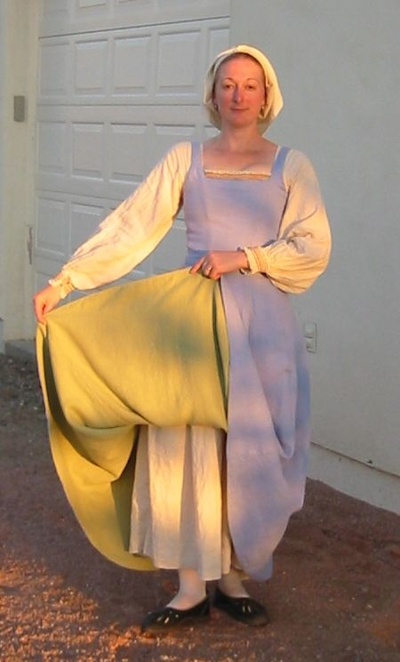 Heather's Pages (http://www.heatherspages.net). Gallery of her Flemish Dress. This shows a reversible kirtle. I love the idea of making my wardrobe more versatile.