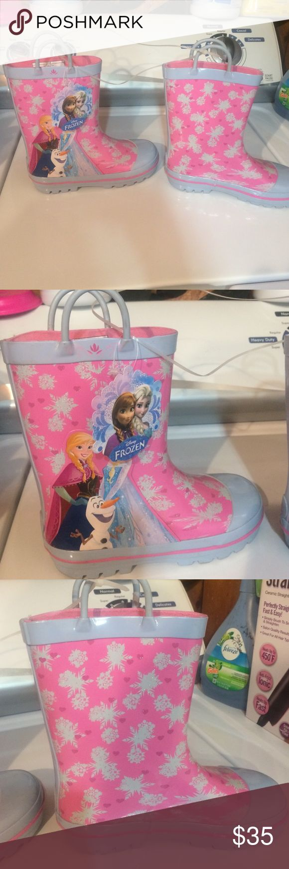 BNWT FROZEN RAIN BOOTS offers welcome 💓 Still attached never tried on never wore. My daughter is scared they won't be comfortable lol they're sparkly pink & gray with princess Anna Queen Elsa and Olaf showing on the outside of this cute stylish boot Disney Shoes Rain & Snow Boots