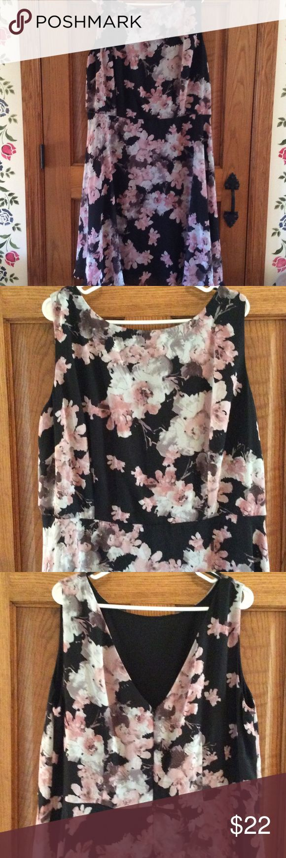 Black and pink floral dress Blank pink and grey floral print. Sheer over black lining. V back with zipper. Excellent condition Dress Barn Dresses Midi