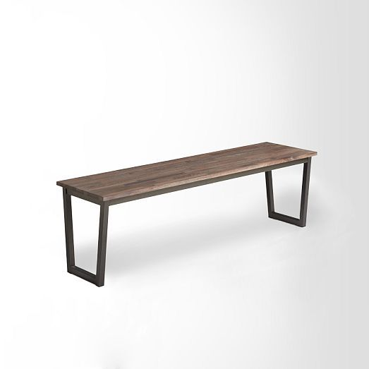 "Oblique Bench: Solid walnut top in a distressed finish. Black powder-coated steel legs. 59""w x 16""d x 17.5""h. $399"