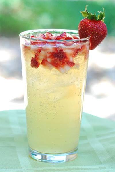A yummy summer mocktail that the whole family can enjoy!    - 4 oz fresh lemonade - 4 oz ginger ale - 3 medium strawberries