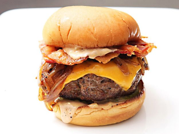 The ultimate bacon cheeseburger with beef cooked in bacon fat, a bacon fat mayonnaise, onions caramelized in bacon fat, buns toasted in bacon fat, and a crisp bacon weave topping. Here's how to make it.