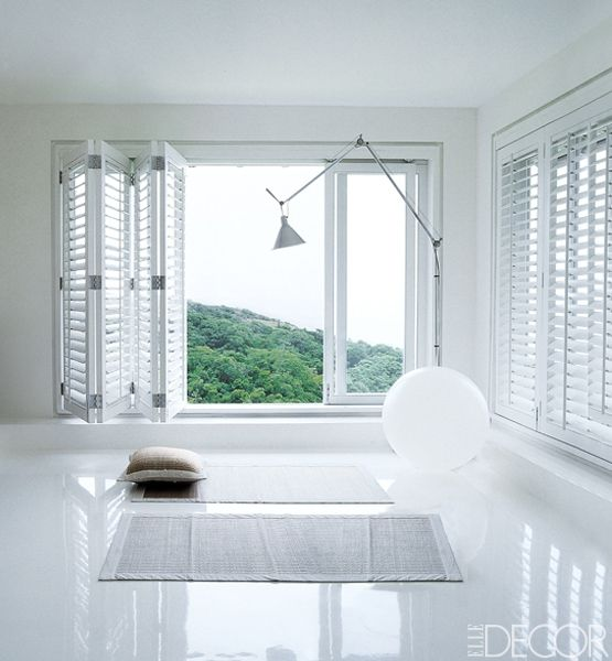 8 Ways To Make Over Your Windows - Love the white retractable louvered shutters... gives a nice clean (but not septic) fresh feeling to the room