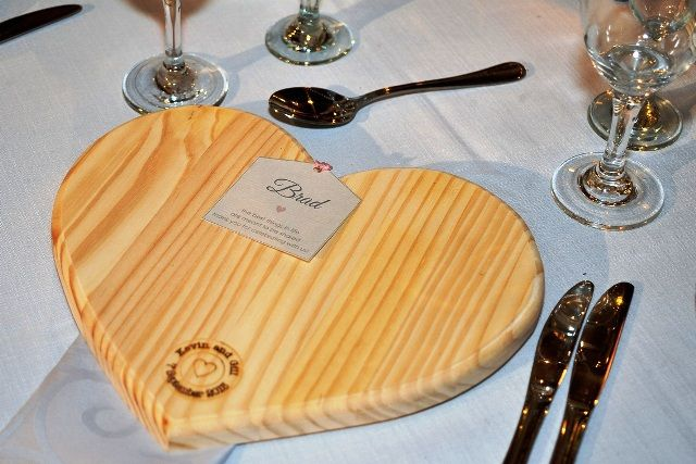 Heart shaped wooden board for individual place setting.