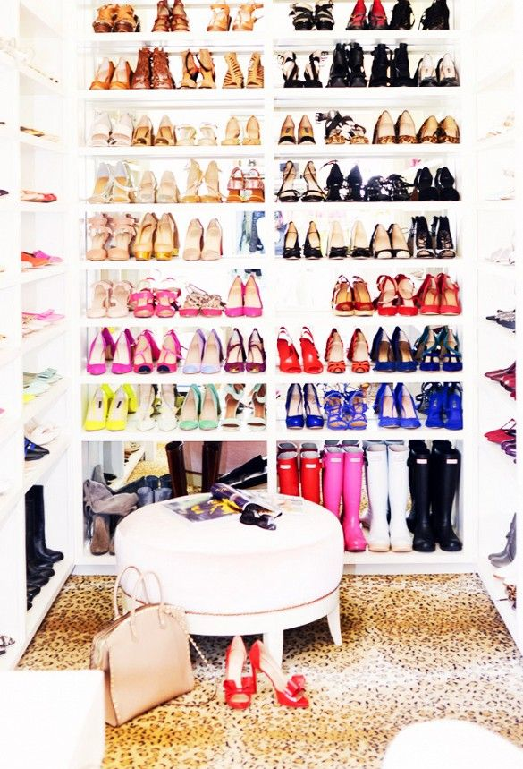 Rachel Parcell of Pink Peonies super girly and organized shoe closet with a chic animal print rug