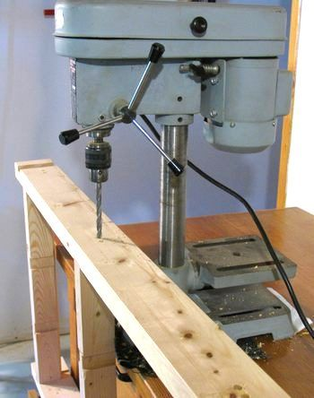 Using a small drill press to drill extra long pieces