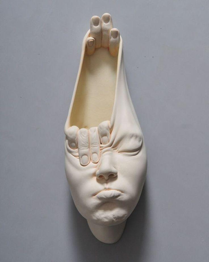 Open Mind surreal face sculpture by Johnson Tsang