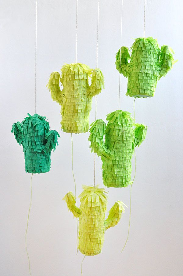 Feeling especially festive? Make these adorable Mini Cactus Piñatas from Oh Happy Day! #cincodemayo #holidays #celebrate #DIY