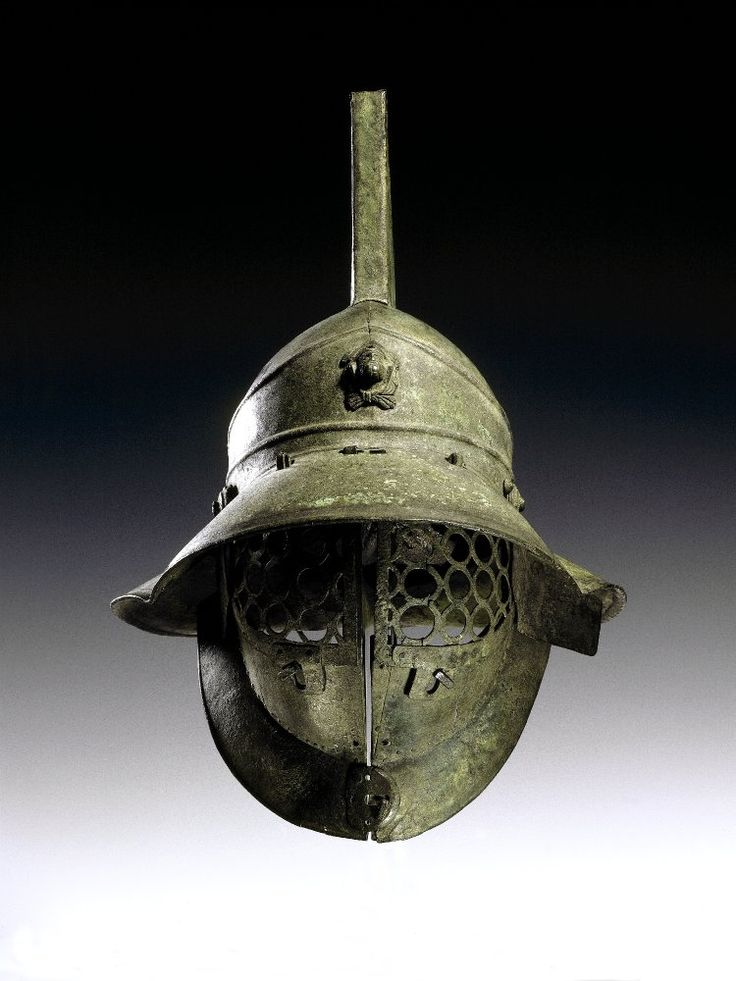 Bronze gladiator's helmet. It has a grille of linked circles to protect the face, and a broad brim to protect the back and sides of the head. At the front of the helmet is a medallion of Hercules. Culture/periodRoman said to have been found in the gladiators' barracks at Pompeii.