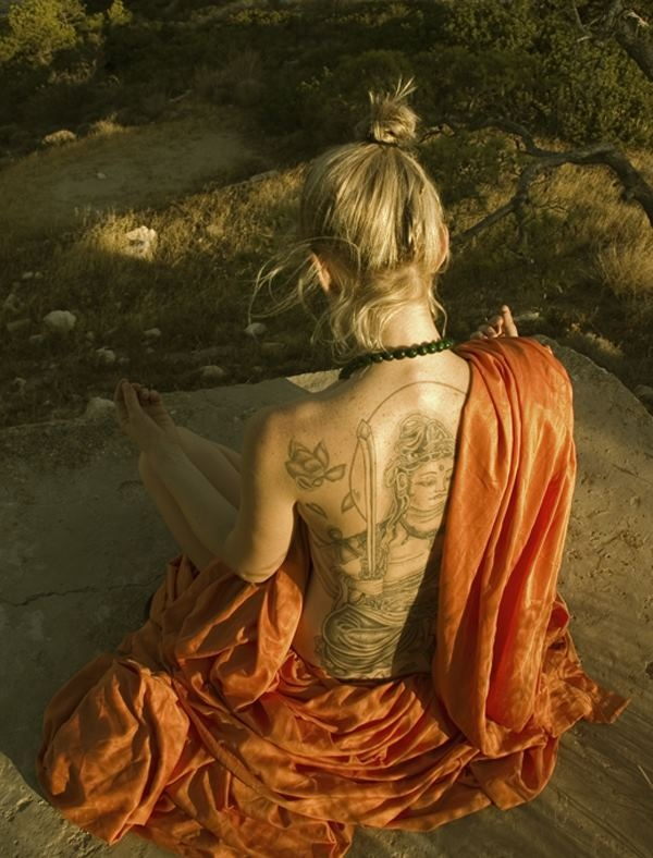 Very Inspirational Girl With A Full Back Spiritual Tattoo