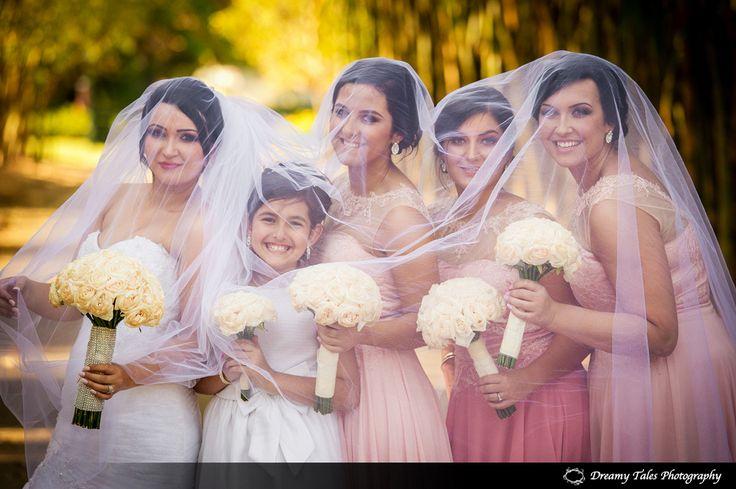 Bride and her Bridesmaids under veil in Brisbane Botanical Gardens