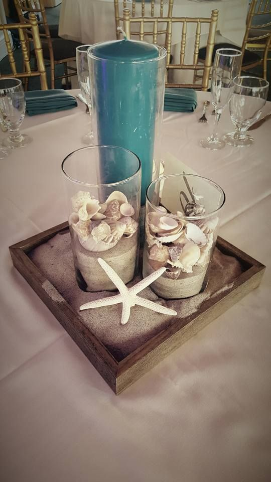 Simple but cute beach themed centerpiece| cylinder vases| beach shell and sand centerpiece| Tall candle centerpiece| Starfish centerpiece: