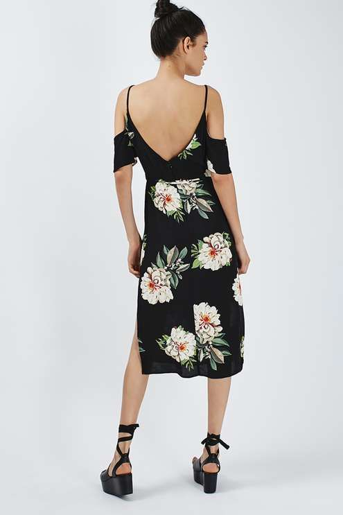 Look to elegant tea party florals for the new season. A fuss-free style, this midi dress comes gently cinched at the waistline, detailed with a self-tie belt to pull the silhouette together. Softly draped cold shoulder style sleeves compliment a v-neckline, while a demure midi hemline makes this style perfect occasional dressing. #Topshop