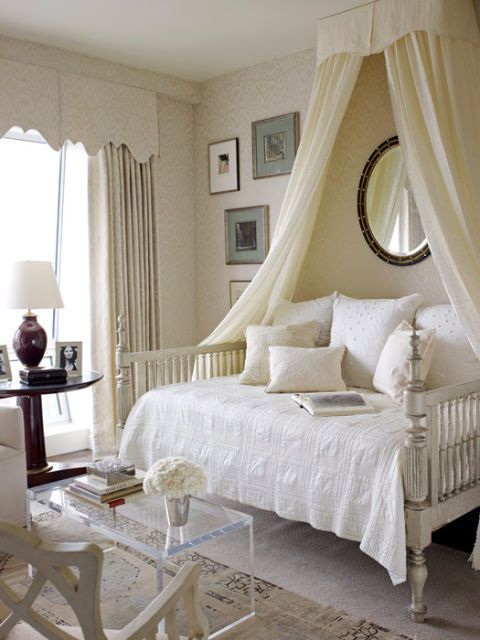Turn an office's daybed into a cozy spot by hanging wall fabric and a mirror.  (Wall fabric and curtains, Mark Alexander by Romo's Jahangir. Bed by Jim Howard. Bedding by Wamsutta.)