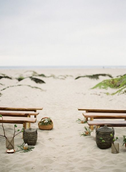Simple, natural ocean backdrop. Like the benches with just a touch of decoration. -Aisle Style – 10 Beautiful Ceremony Decor Ideas (for any budget and location)