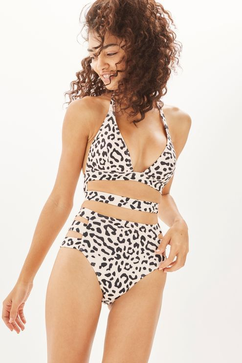 The latest swimwear range at Topshop, Wolf & Whistle has got your summer beach style sorted. These high waisted bikini bottoms in leopard print feature cut-out detail to the sides.