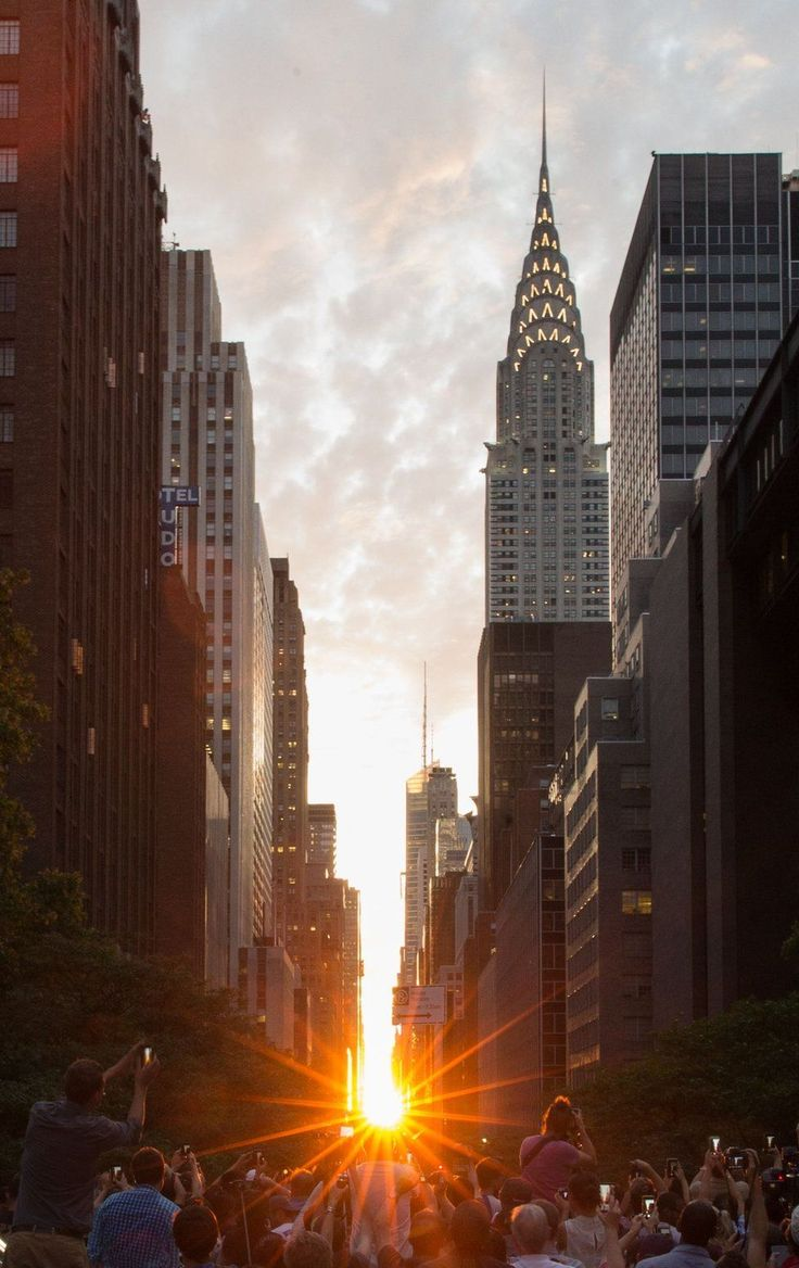 On 11 July, New Yorkers witnessed an urban solar phenomenon, with the Sun setting in alignment with the city's skyscrapers and giving an effect fans say is reminiscent of England's Stonehenge – Manhattanhenge.