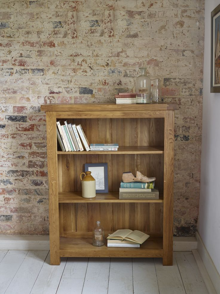 The Original Rustic Solid Oak Small Bookcase has a traditional, farmhouse appearance which will grace modern and more classically decorated homes alike. Crafted by skilled joiners from the finest cuts of solid oak, it features a slightly darker colouring to our other oak ranges, which is achieved by applying a subtly stained wax to the timbers.